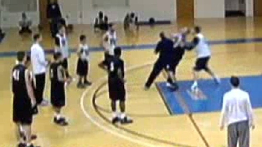 Video allegedly shows Holy Family University coach John O'Connor knocking down player Matt Kravchuk during a January practice.