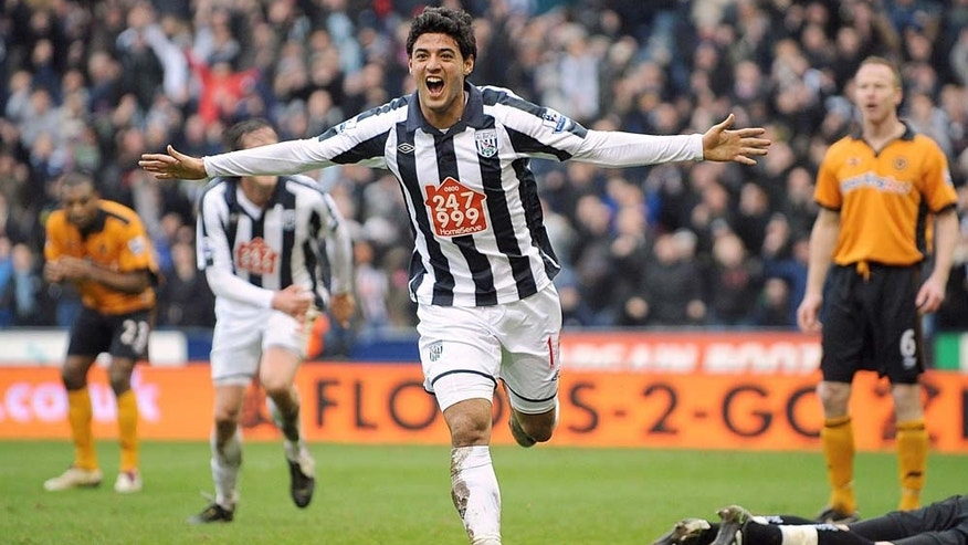 West Bromwich Albion's Carlos Alberto Vela celebrates scoring the equalising goal against Wolverhampton Wanderers during the English Premier League soccer match at The Hawthorns, West Bromwich, England, Sunday Feb. 20, 2011. The match ended in a 1-1 draw. (AP Photo/PA) UNITED KINGDOM OUT  - NO INTERNET/MOBILE USAGE WITHOUT FAPL LICENCE - SEE IPTC SPECIAL INSTRUCTIONS FIELD FOR DETAILS