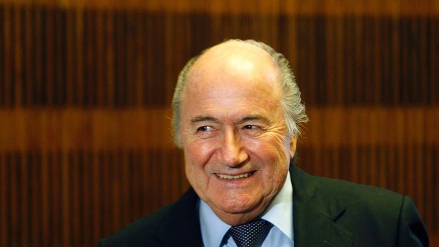 FIFA President Sepp Blatter smiles after holding a press conference in Prague, Czech Republic, Tuesday, Feb. 8, 2011. (AP Photo/Petr David Josek)