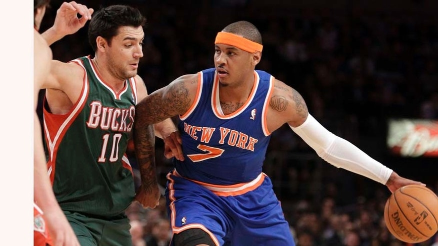 New York Knicks' Carmelo Anthony (7) works against Milwaukee Bucks' Carlos Delfino (10) during the first half of an NBA basketball game Wednesday, Feb. 23, 2011, in New York. (AP Photo/Kathy Willens)