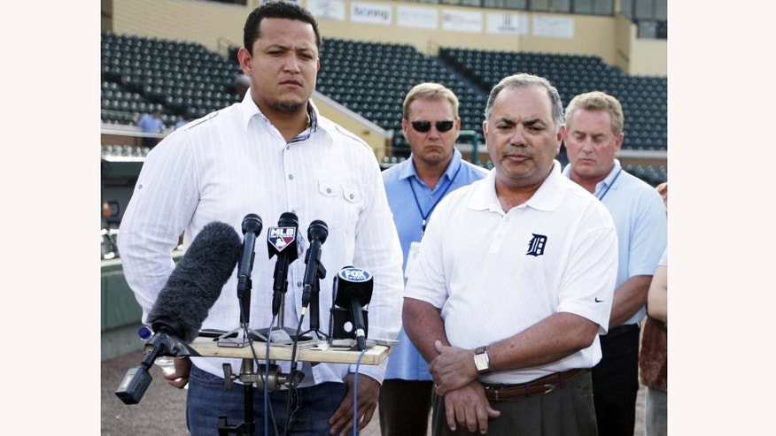 Detroit Tigers Miguel Cabrera with vice president, assistant GM Al Avila, right interpreting for him, speaking for the first time about his DUI arrest at the Tigers Spring Training complex  in Lakeland, Florida on Thursday, Feb. 24,  2011. (AP Photo/Detroit Free Press, Julian H. Gonzalez)