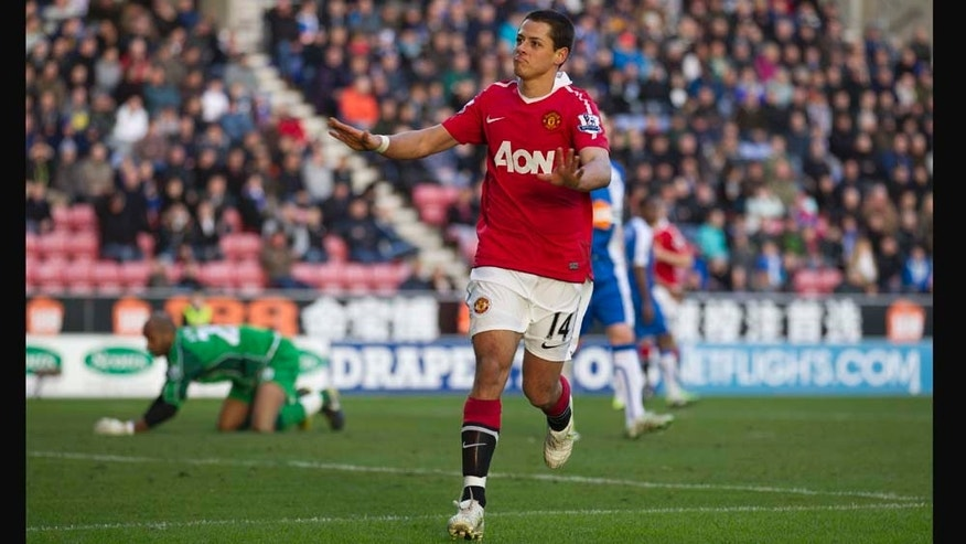 Manchester United's Javier Hernandez celebrates after scoring his second goal against Wigan Athletic during their English Premier League soccer match at The DW Stadium, Wigan, England, Saturday Feb. 26, 2011. (AP Photo/Jon Super) NO INTERNET/MOBILE USAGE WITHOUT FOOTBALL ASSOCIATION PREMIER LEAGUE(FAPL)LICENCE. EMAIL info@football-dataco.com FOR DETAILS