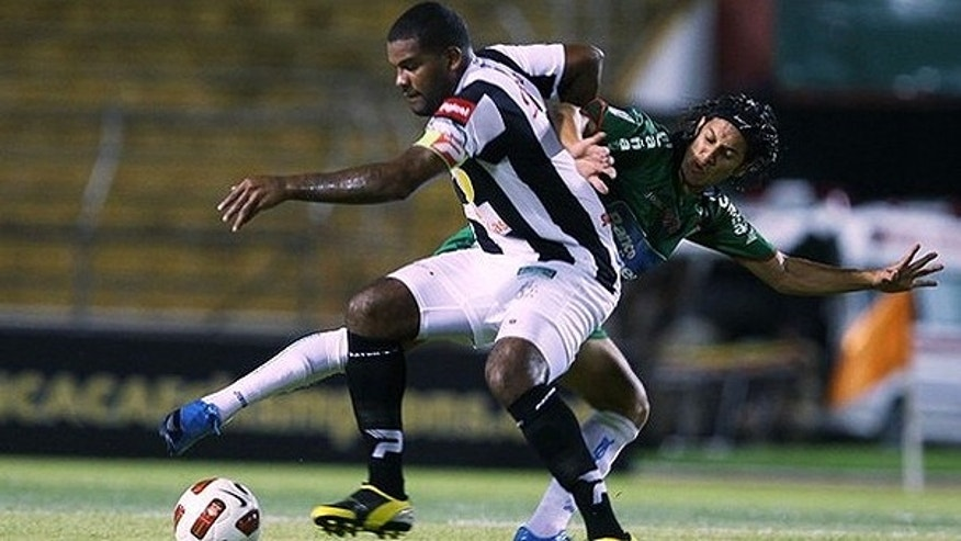 Aug. 4, 2010: s Tauro fights for the ball with Randy Diamond Honduras's Marathon during their CONCACAF Champions League soccer match in San Pedro Sula.