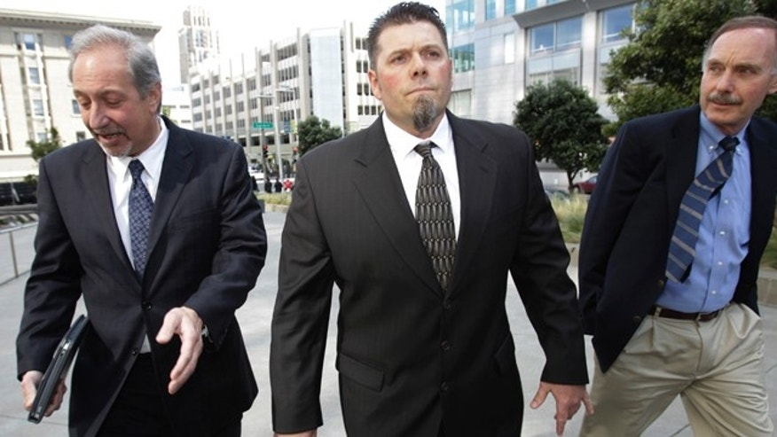 March 1: Greg Anderson, center, former trainer of baseball player Barry Bonds, arrives with his attorney Mark Geragos, left, and a reporter, right, at federal court in San Francisco.