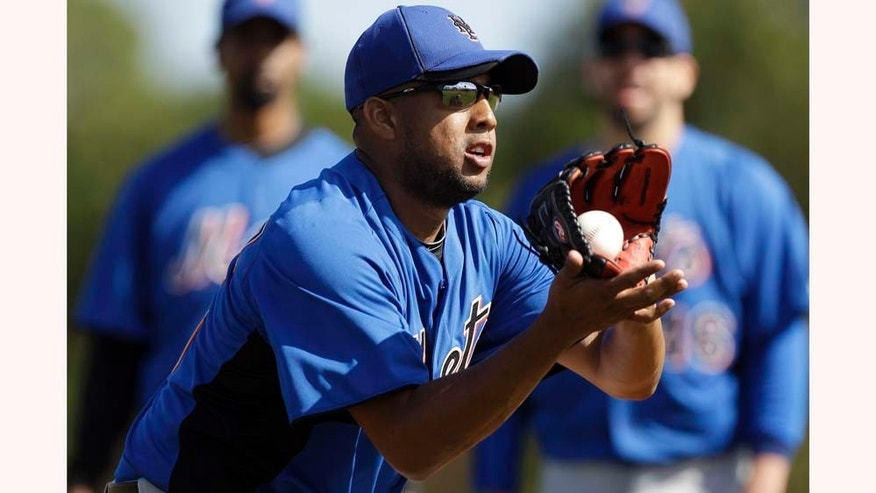 New York Mets pitcher Francisco Rodriguez fields a ball while taking part in drills during spring training baseball Friday, Feb. 18, 2011, in Port St. Lucie, Fla. (AP Photo/Jeff Roberson)