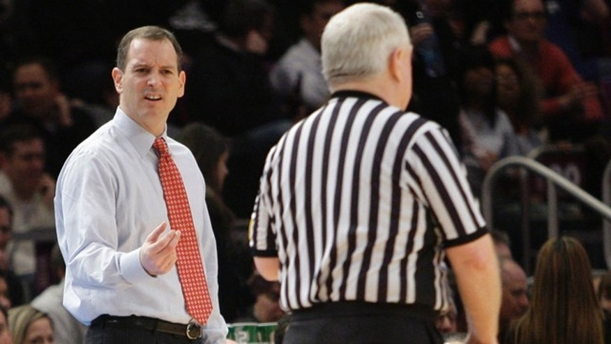 March 9: Rutgers coach Mike Rice, left, argues with a referee during the first half of an NCAA college basketball game against St. Johns at the Big East Championship at Madison Square Garden in New York.