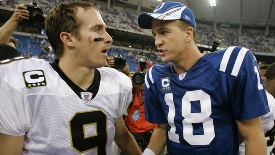 In this Sept. 6, 2007, file photo, Indianapolis Colts quarterback Peyton Manning, right, and New Orleans Saints quarterback Drew Brees meet after the Colts won 41-10 Colts in an NFL football game in Indianapolis.