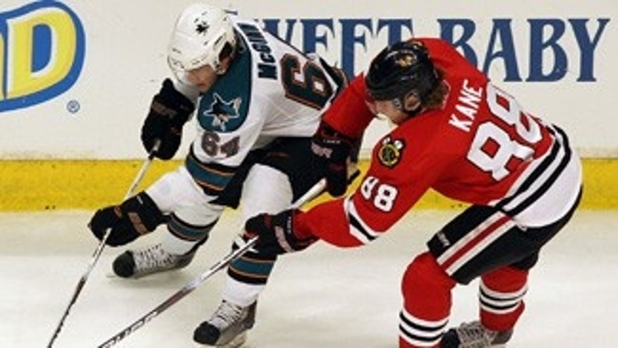 CHICAGO - MAY 21:  Jamie McGinn #64 of the San Jose Sharks moves the puck against Patrick Kane #88 of the Chicago Blackhawks in overtime of Game Three of the Western Conference Finals during the 2010 NHL Stanley Cup Playoffs at the United Center on May 21, 2010 in Chicago, Illinois.  (Photo by Jamie Squire/Getty Images) *** Local Caption *** Jamie McGinn;Patrick Kane