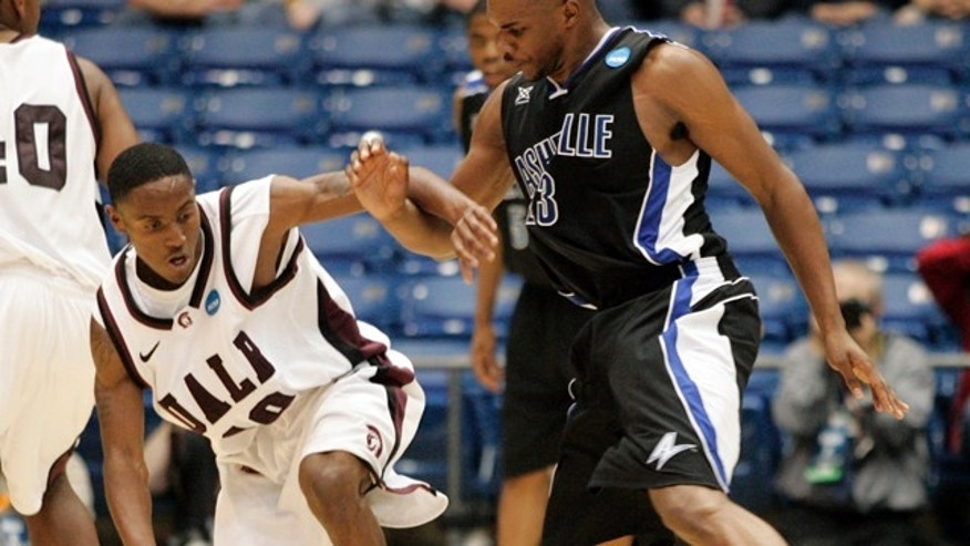 March 15, 2011: Arkansas-Little Rock guard D'Andre Williams (10) is guarded by North Carolina-Asheville forward John Williams (23) in the first half of a first round NCAA college basketball game.