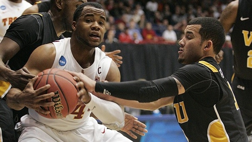 March 16: Southern California guard Donte Smith, left, is pressured by Virginia Commonwealth guard Joey Rodriguez, right, in the first half of a first-round NCAA college basketball tournament game in Dayton, Ohio.