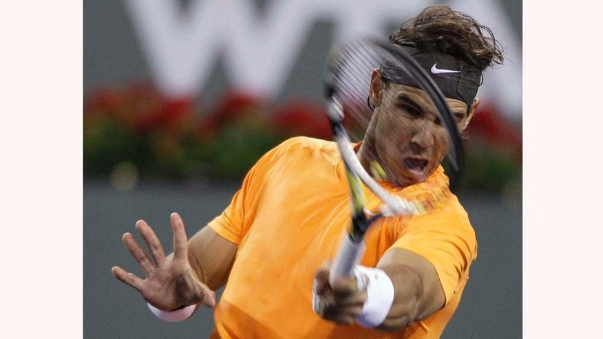 Rafael Nadal, of Spain, returns a shot to Somdev Devvarman, of India, at the BNP Paribas Open tennis tournament in Indian Wells, Calif., Wednesday, March 16, 2011. (AP Photo/Darron Cummings)