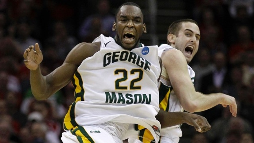 March 18: George Mason's Mike Morrison (22) and Luke Hancock celebrate a 61-57 win over Villanova in an East regional NCAA college basketball tournament second round game in Cleveland.