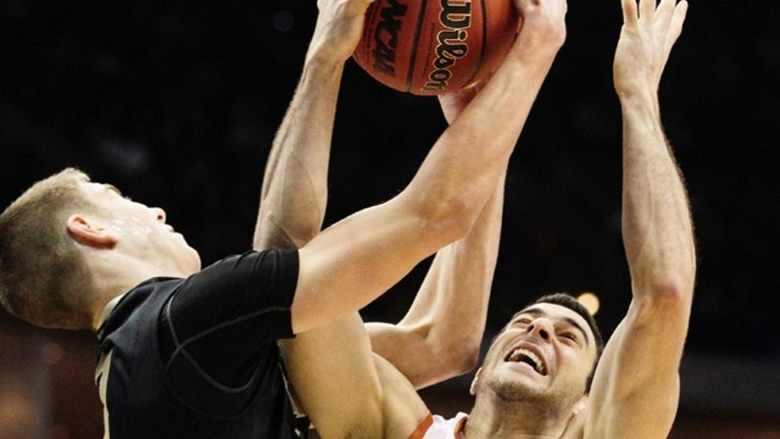 March 18: Oakland, Mich. guard Travis Bader and Texas guard Dogus Balbay go after a rebound in the first half of a West Regional NCAA tournament second round college basketball game in Tulsa, Okla.
