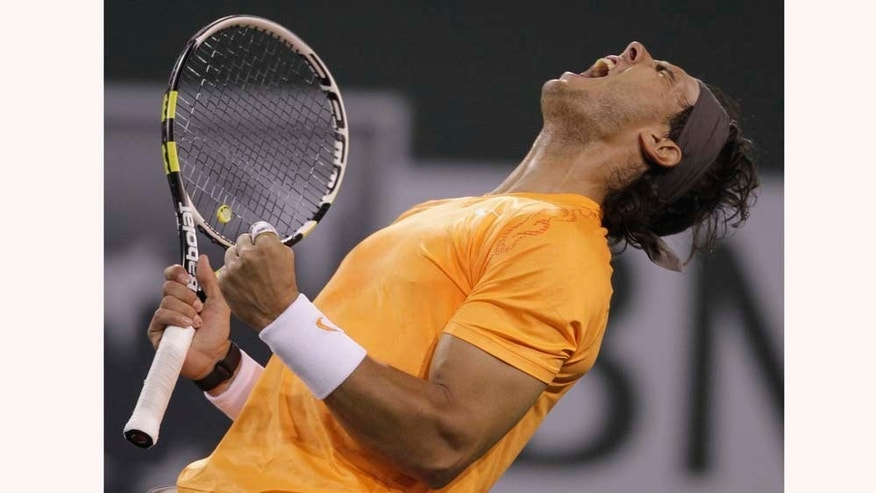 Rafael Nadal of Spain reacts during his match against Ivo Karlovic of Croatia during a quarterfinals match at the BNP Paribas Open tennis tournament in Indian Wells, Calif., Thursday, March 17, 2011. Nadal won 5-7, 6-1, 7-6 (7). (AP Photo/Darron Cummings)
