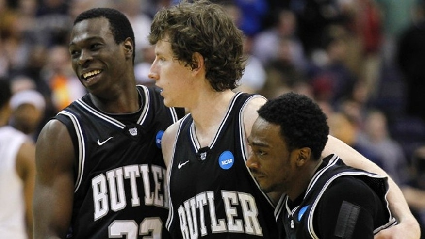 March 19: Butler players, from left, Khyle Marshall, Matt Howard and Shawn Vanzant walk off the court after the Southeast Regional third-round NCAA tournament college basketball game against Pittsburgh at the Verizon Center in Washington.