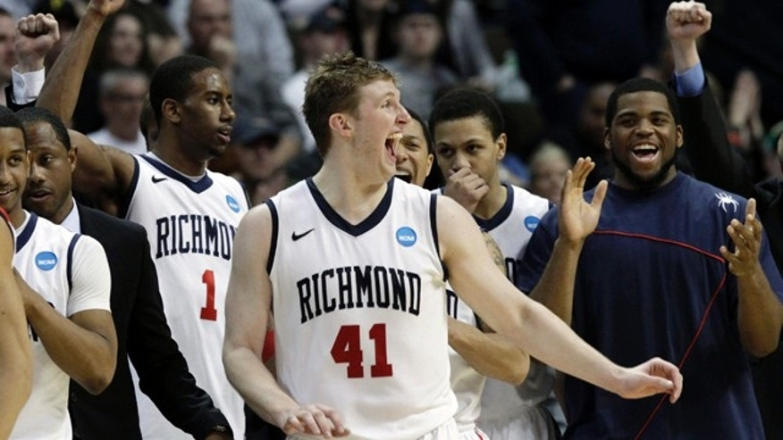 March 19: Richmond players celebrate at the end of the game after beating Morehead State 65-48 in a Southwest regional third round NCAA tournament college basketball game in Denver.