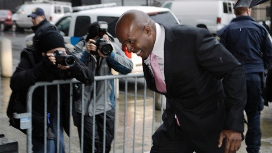 March 24: Barry Bonds arrives in the rain for his criminal trial at a federal courthouse in San Francisco.