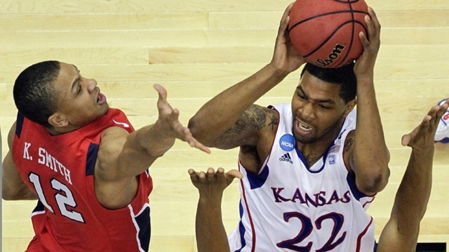 Kansas' Marcus Morris shoots over Richmond's Kevin Smith (12) and Justin Harper during the first half of a Southwest regional semifinal game in the NCAA college basketball tournament Friday, March 25, 2011, in San Antonio.  (AP Photo/Eric Gay)
