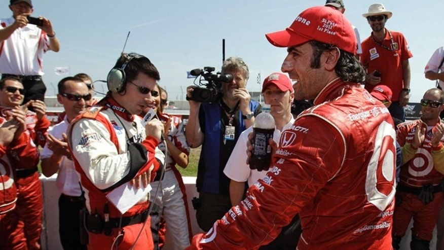 March 27, 2011: Dario Franchitti, right, smiles after winning the IndyCar Honda Grand Prix of St. Petersburg auto race.