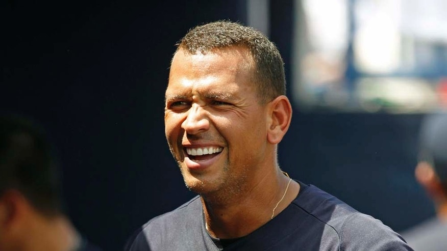 New York Yankees' Alex Rodriguez smiles in the dugout after hitting a two-run home run off Pittsburgh Pirates starting pitcher Kevin Correia in the first inning of a spring training baseball game at Steinbrenner Field in Tampa, Fla., Saturday, March 26, 2011. (AP Photo/Kathy Willens)