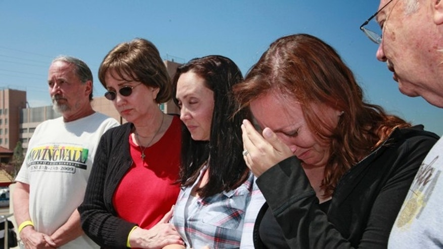 April 5, 2011: Family members of attacked Giant fan, Bryan Stow, gather for a news conference outside USC Hospital in Los Angeles. They are, from left, John Devitt, uncle, Elizabet Stow, mother, Bonnie Stow, sister, Erin Stow, sister and Dave Stow, father. According doctors, Bryan Stow is showing signs of brain damage and remains in critical condition.