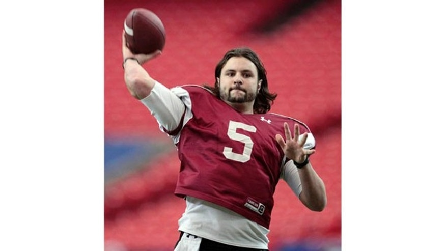 Dec. 29: South Carolina quarterback Stephen Garcia throws a pass during practice for the Chick-fil-A Bowl NCAA college football game against Florida State in Atlanta.
