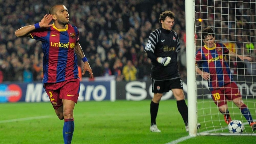 FC Barcelona's Daniel Alves from Brazil, left, reacts after scoring against Shakhtar Donetsk during a quarterfinal first leg Champions League soccer match at the Nou Camp, in Barcelona, Spain, Wednesday, April 6, 2011. (AP Photo/Manu Fernandez)