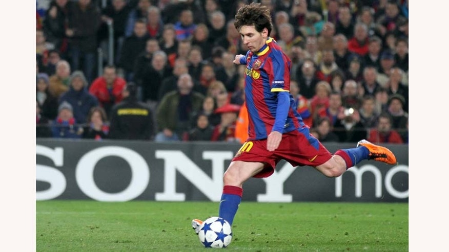 FC Barcelona's Lionel Messi, of Argentina, prepares to kick the penalty during a Champions League, round of 16, second leg soccer match against Arsenal at the Nou Camp, in Barcelona, Spain, Tuesday, March 8, 2011. (AP Photo/Felice Calabro')