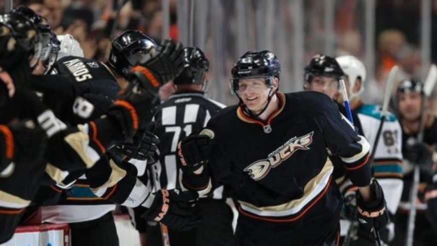 April 6: Anaheim Ducks right wing Corey Perry is greeted by teammates after scoring against the San Jose Sharks in the first period of an NHL hockey game in Anaheim, California.