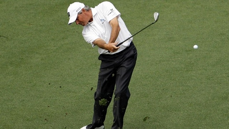 April 8: Fred Couples hits off the ninth fairway during the second round of the Masters golf tournament in Augusta, Ga.