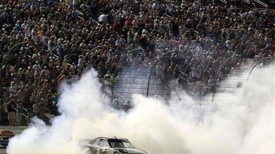 April 9: Matt Kenseth does a burnout on the front stretch as he celebrates his win in the NASCAR Sprint Cup Series auto race at Texas Motor Speedway in Fort Worth, Texas. (AP)
