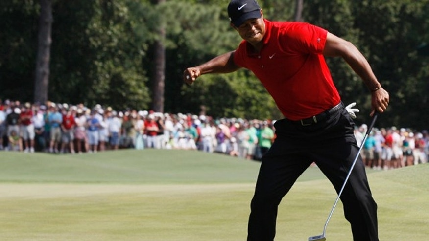 April 10, 2011: Tiger Woods reacts after an eagle putt on the eighth hole during the final round of the Masters golf tournament.