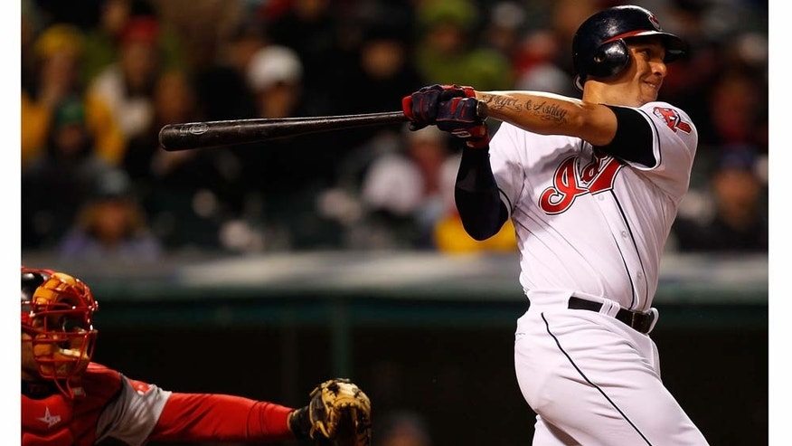 CLEVELAND - APRIL 06:  Asdrubal Cabrera #13 of the Cleveland Indians hits an RBI single off of Daisuke Matsuzaka #18 of the Boston Red Sox during the game on April 6, 2011 at Progressive Field in Cleveland, Ohio.  (Photo by Jared Wickerham/Getty Images)