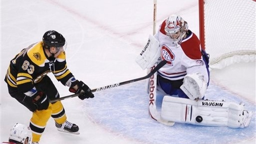 April 14: Boston Bruins center Brad Marchand, left, shoots as Montreal Canadiens goalie Carey Price makes the save in the first period of a first-round NHL hockey playoff game in Boston. (AP)