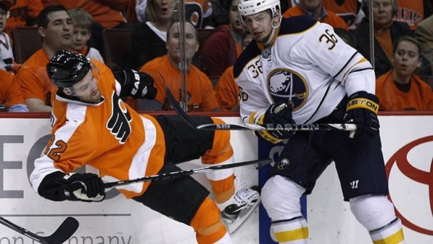 April 14: Philadelphia Flyers' Ville Leino, left, of Finland, is knocked down by Buffalo Sabres' Patrick Kaleta in the first period of Game 1 of a first-round NHL hockey playoff series in Philadelphia.