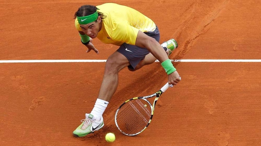 Rafael Nadal of Spain plays a return to Richard Gasquet of France during their third round match of the Monte Carlo Tennis Masters tournament in Monaco, Thursday, April 14 , 2011. (AP Photo/Lionel Cironneau)