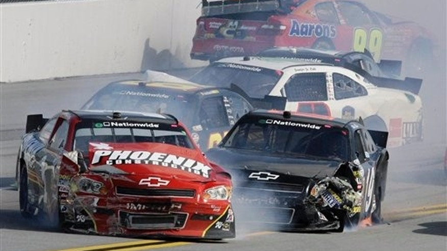 April 16: Drivers Jamie McMurray, front left, and Mike Bliss, front right, collide in foreground with others cars during the NASCAR Nationwide series Aaron's 312 auto race at Talladega Superspeedway in Talladega, Ala. (AP)