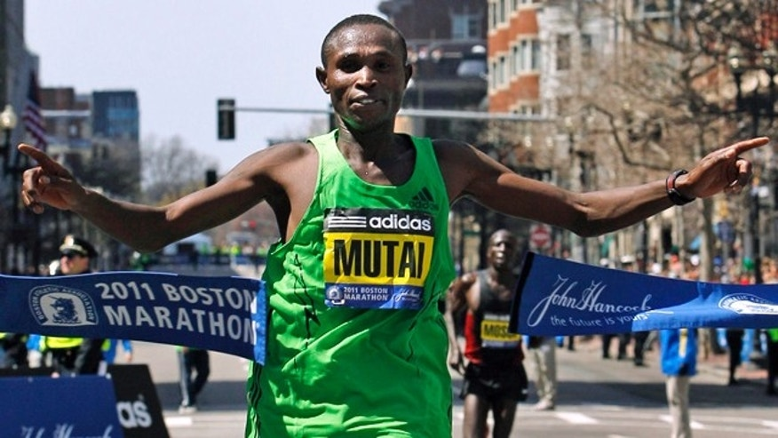 April 18, 2011: Winner Geoffrey Mutai of Kenya crosses the finish line of the 115th Boston Marathon.