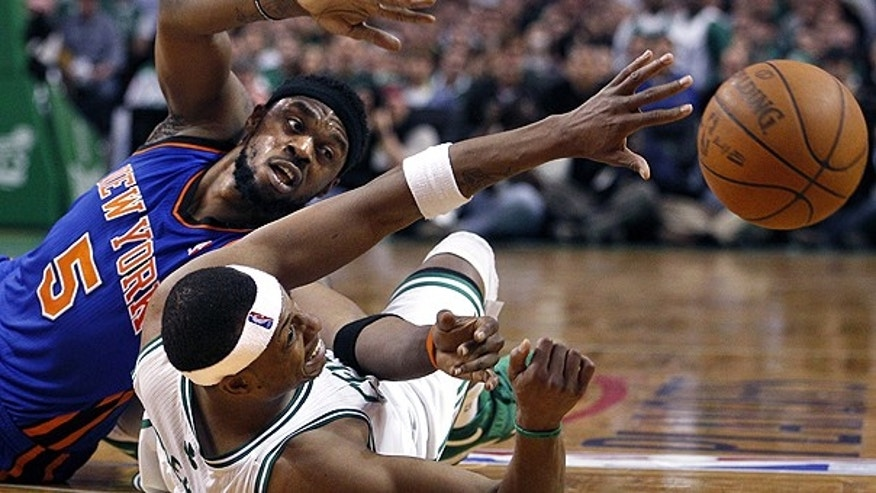 April 19: Boston Celtics forward Paul Pierce (34) gets a pass away, against the defense of New York Knicks guard Bill Walker (5) during the second half of Game 2 of a first-round NBA basketball playoff series, in Boston.