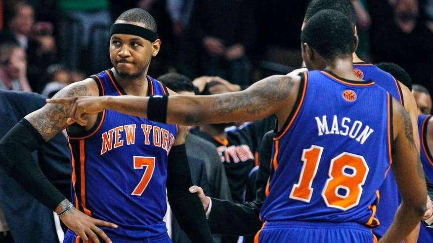 New York Knicks forward Carmelo Anthony (7), guard Roger Mason (18) and teammates huddle during a timeout against the Boston Celtics near the end of Game 2 of a first-round NBA basketball playoff series, in Boston on Tuesday, April 19, 2011. The Celtics won 96-93. (AP Photo/Elise Amendola)