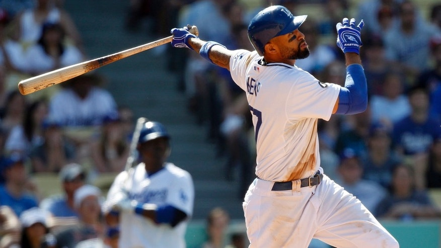 Los Angeles Dodgers' Matt Kemp hits a game winning two-run home run to beat the St. Louis Cardinals during the ninth inning of a baseball game in Los Angeles, Sunday, April 17, 2011. Dodgers won the game 2-1.  (AP Photo/Alex Gallardo)