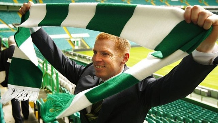 June 9, 2010: Celtic football team's new manager Neil Lennon poses with a club scarf after a press conference announcing his appointment, at Celtic Park stadium in Glasgow, Scotland.