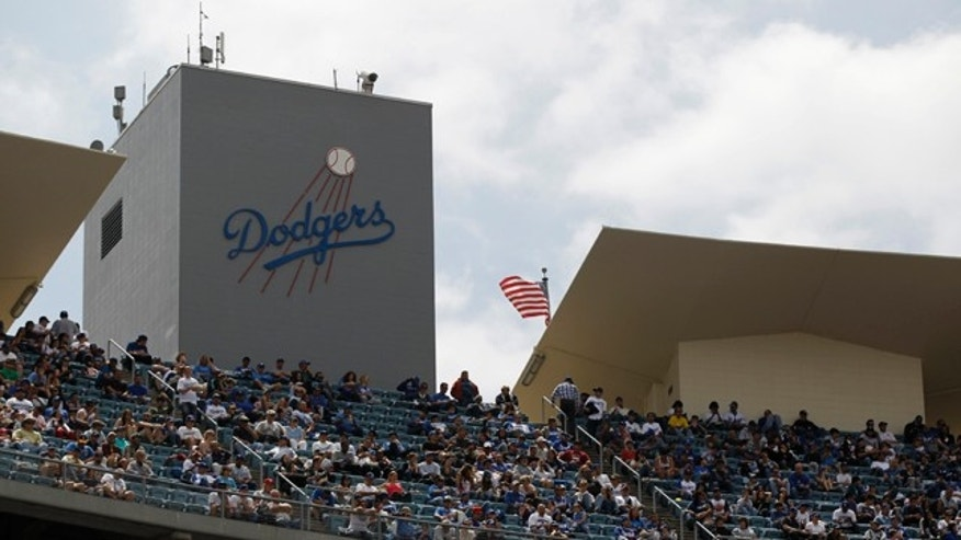 April 21: Fans sit in the top deck of Dodger Stadium during a baseball game between the Los Angeles Dodgers and Atlanta Braves in Los Angeles. Baseball commissioner Bud Selig is taking away control of the Dodgers from owner Frank McCourt, whose troubled finances and unresolved divorce settlement have seemingly paralyzed the once-proud franchise. (AP)