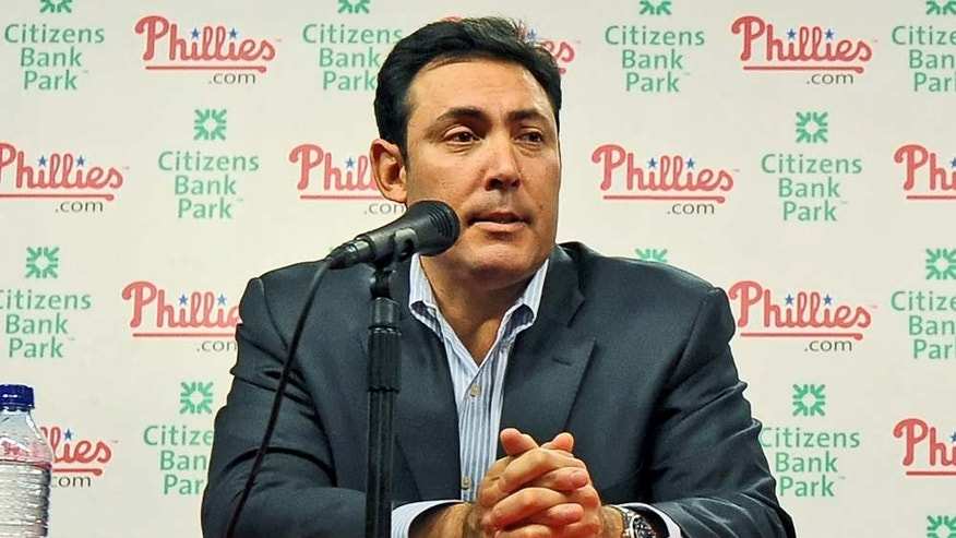 PHILADELPHIA - DECEMBER 16: Pitcher Roy Halladay (R) of the Philadelphia Phillies and senior vice president and general manager Ruben Amaro, Jr. answer questions from the media on December 16, 2009 at Citizens Bank Park in Philadelphia, Pennsylvania. (Photo by Drew Hallowell/Getty Images)