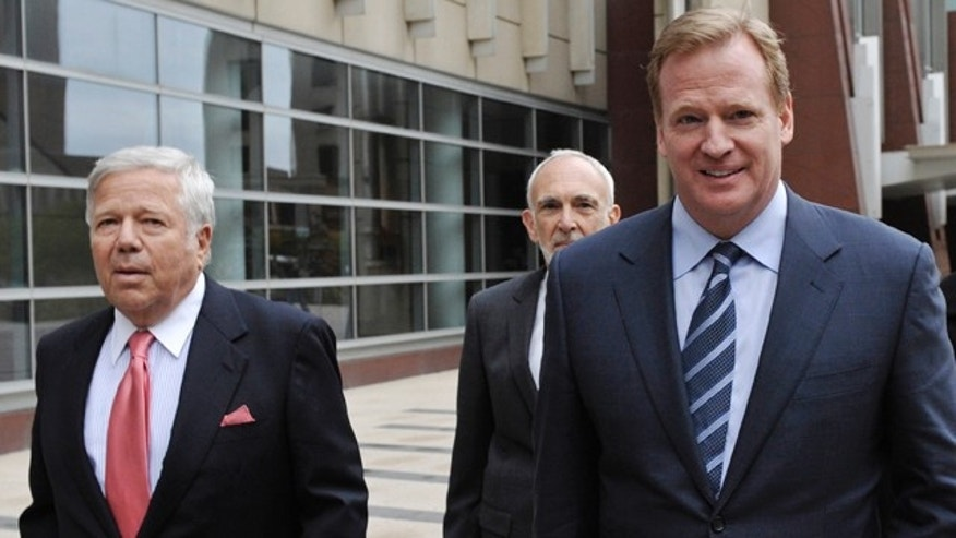 April 14: New England Patriots owner Robert Kraft, left, and NFL commissioner Roger Goodell, right, leave the federal courthouse along with NFL outside attorney Bob Betterman, center.