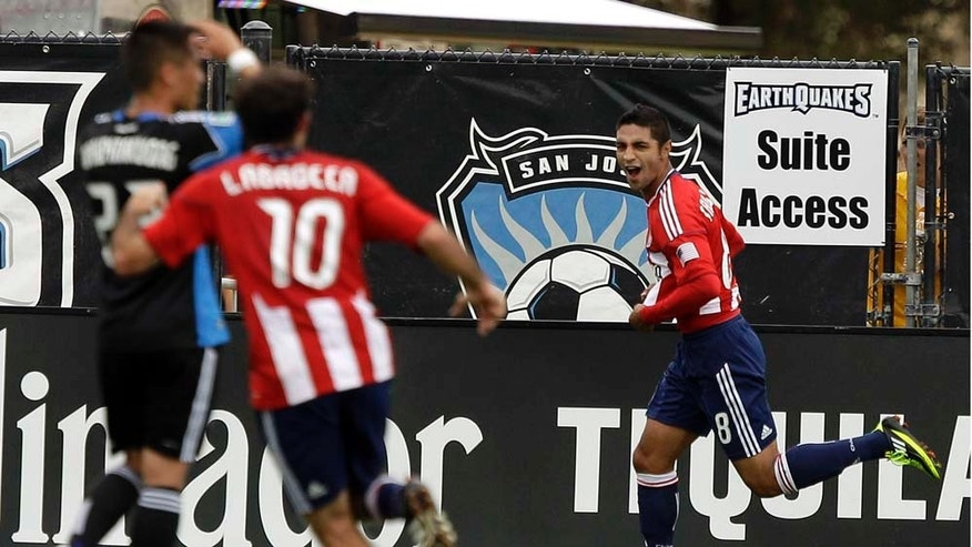 Chivas USA's Mariano Trujillo (8) celebrates after scoring against the San Jose Earthquakes during the second half of an MLS soccer game in Santa Clara, Calif., Saturday, April 23, 2011. Chivas USA won 2-1. (AP Photo/Marcio Jose Sanchez)