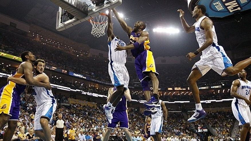 April 24: New Orleans Hornets center Emeka Okafor (50) blocks a shot by Los Angeles Lakers guard Kobe Bryant (24), center, during the second quarter of game four of a first-round NBA basketball playoff series in New Orleans.