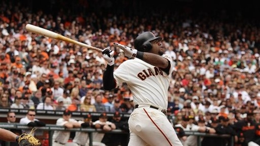 In this photo taken Saturday April 23, 2011, San Francisco Giants' Pablo Sandoval is at bat against the Atlanta Braves during their baseball game in San Francisco. No longer the stressed-out, pressing third baseman he was a year ago for the Giants while fighting significant weight gain and his confidence, Sandoval has a spring in his step again. And, more importantly for the reigning World Series champions, some serious pop in his bat. (AP Photo/Eric Risberg)