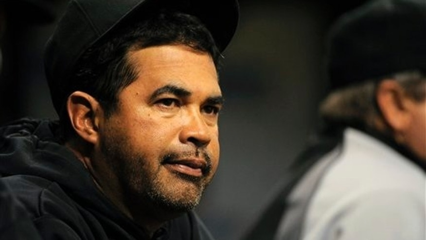 Chicago White Sox manager Ozzie Guillen looks on from the dugout during the final moments of their 4-1 loss to the Tampa Bay Rays during a Major League Baseball game on Wednesday, April 20, 2011, in St. Petersburg, Fla. (AP Photo/Brian Blanco)