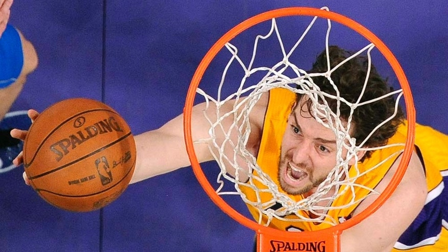 Los Angeles Lakers forward Pau Gasol, of Spain, puts up a shot during the first half in Game 2 of a second-round NBA playoff basketball series against the Dallas Mavericks, Wednesday, May 4, 2011, in Los Angeles. (AP Photo/Chris Pizzello)